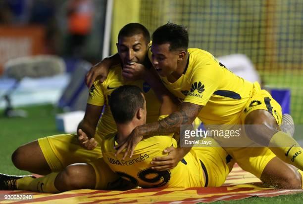 Leonardo Jara of Boca Juniors celebrates with teammates Ramon Abila and Edwin Cardona after scoring during a match between Boca Juniors and Tigre as...
