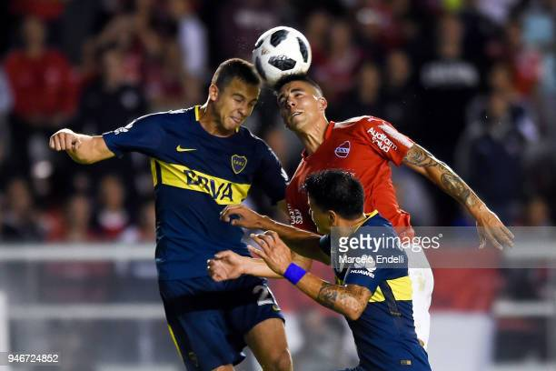 Leonardo Jara of Boca Juniors fight for the ball with Leandro Fernandez of Independiente during a match between Independiente and Boca Juniors as...