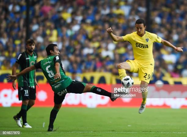 Leonardo Jara of Boca Juniors fights for ball with Marcos Gelabert of San Martin during a match between Boca Juniors and San Martin de San Juan as...