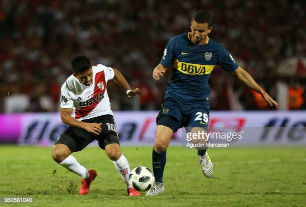 Leonardo Jara of Boca Juniors fights for the ball with Gonzalo Martinez of River Plate during the Supercopa Argentina 2018 between River Plate and...