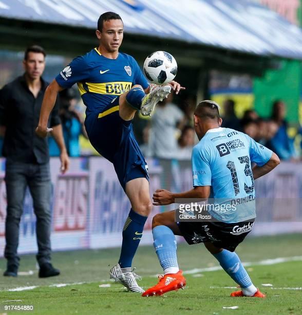 Leonardo Jara of Boca Juniors fights for the ball with Matias Orihuela of Temperley during a match between Boca Juniors and Temperley as part of the...