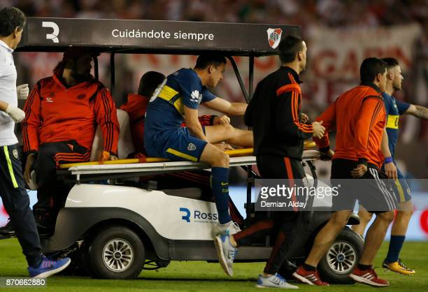 Leonardo Jara of Boca Juniors leaves the field after being injured during during a match between River Plate and Boca Juniors as part of the...