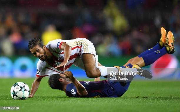 Leonardo Koutris of Olympiacos and Sergi Roberto of Barcelona battle for possession during the UEFA Champions League group D match between FC...