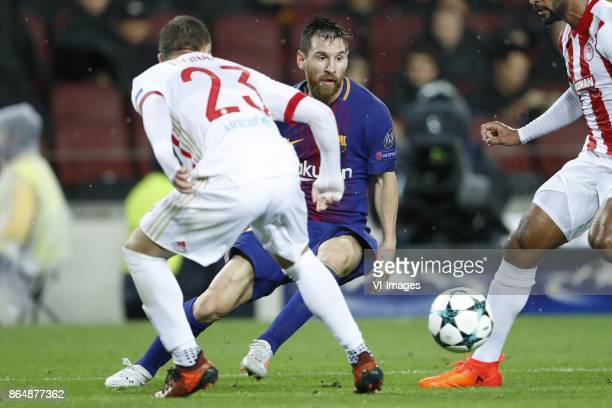 Leonardo Koutris of Olympiacos Lionel Messi of FC Barcelona Alaixys Romao of Olympiacos during the UEFA Champions League group D match between FC...
