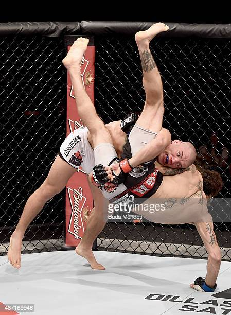 Leonardo Mafra of Brazil attempts a submission against Cain Carrizosa of the United States in their lightweight bout during the UFC Fight Night at...