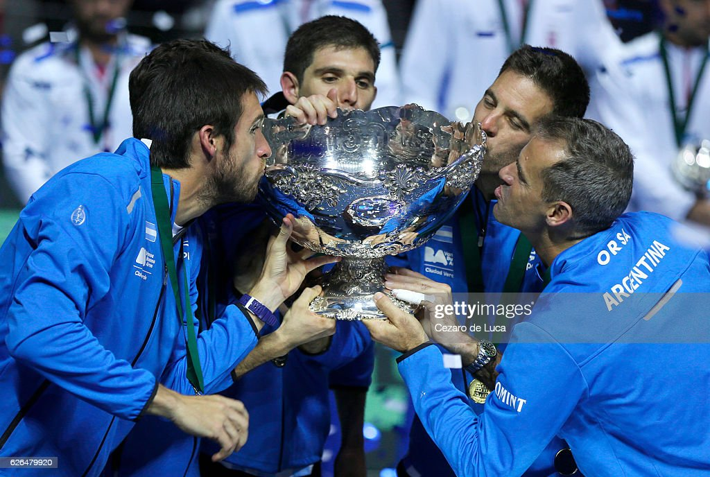 Leonardo Mayer, Guido Pella, Federico Del Bonis, Juan Martin Del Potro of Argentina and Argentina team captain Daniel Orsanic kiss the trophy after winning the 2016 Davis Cup Final between Croatia and Argentina on November 27, 2016 in Zagreb, Croatia.