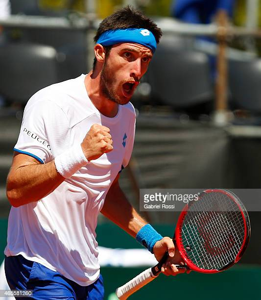 Leonardo Mayer of Argentina celebrates after winning the first set during a singles match between Leonardo Mayer of Argentina and Joao Souza of...