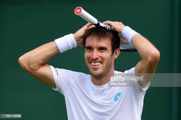 Leonardo Mayer of Argentina celebrates match point in his Men's Singles first round match against Ernests Gulbis of Latvia during Day one of The...
