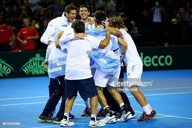 Leonardo Mayer of Argentina celebrates with his teammates including Juan Martin del Potro and Federico Delbonis after winning his singles match...