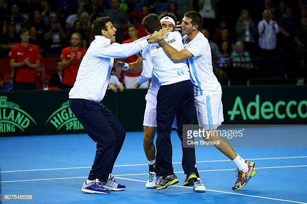 Leonardo Mayer of Argentina celebrates with his teammates Juan Martin del Potro Guido Pella and Federico Delbonis after winning his singles match...
