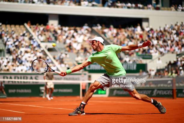 Leonardo Mayer of Argentina plays a backhand during his mens singles fourth round match against Roger Federer of Switzerland during Day eight of the...