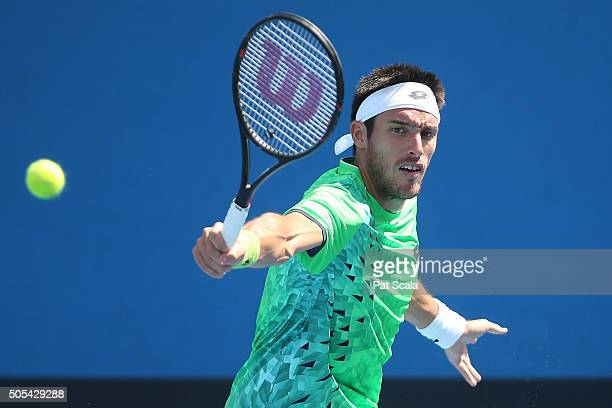 Leonardo Mayer of Argentina plays a backhand in his first round match against Dominic Thiem of Austria during day one of the 2016 Australian Open at...