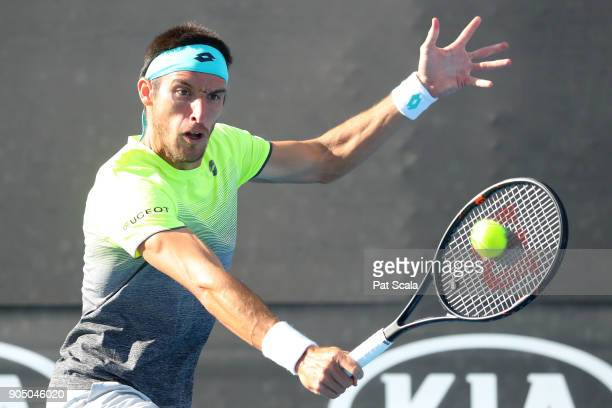 Leonardo Mayer of Argentina plays a backhand in his first round match against Nicolas Jarry of Chile on day one of the 2018 Australian Open at...