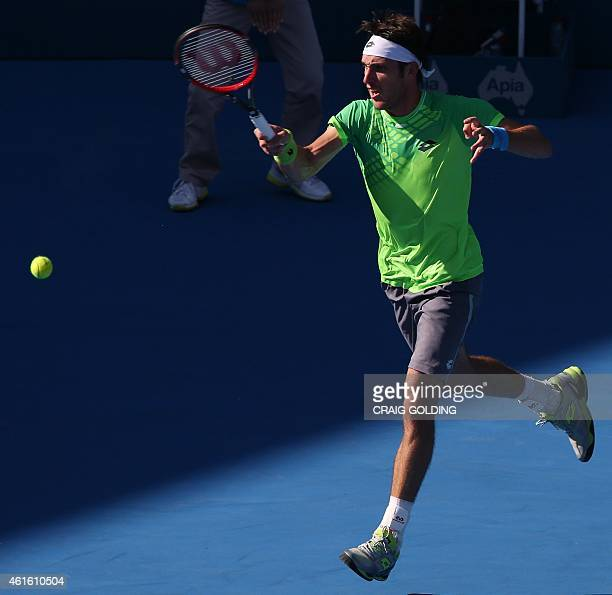 Leonardo Mayer of Argentina plays a forehand against Mikhail Kukushkin of Kazakhstan during their men's singles semi final match on day six of the...