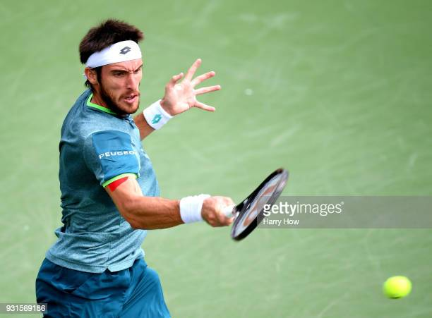 Leonardo Mayer of Argentina plays a forehand in his match against Taro Daniel of Japan during the BNP Paribas Open at the Indian Wells Tennis Garden...