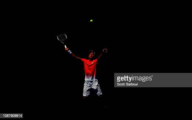 Leonardo Mayer of Argentina plays a shot with Joao Sousa Portugal during their Men's Doubles semi final match against John Peers of Australia and...