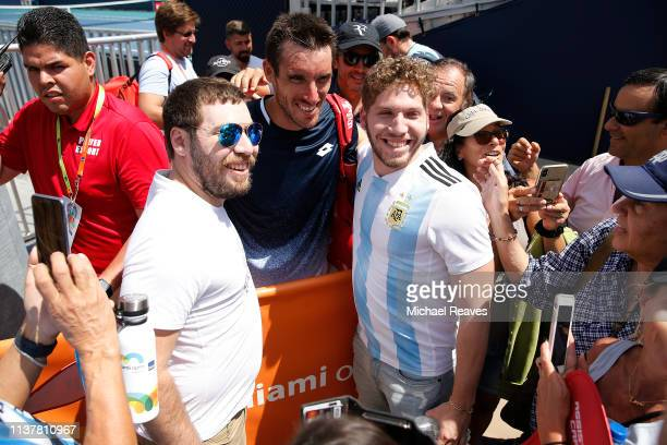 Leonardo Mayer of Argentina poses for a photo with fans after his match against Guido Pella of Argentina during Day 6 of the Miami Open Presented by...