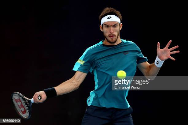 Leonardo Mayer of Argentina returns a shot against Paolo Lorenzi of Italy on day four of the 2017 China Open at the China National Tennis Centre on...