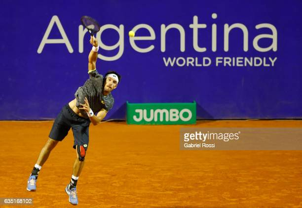 Leonardo Mayer of Argentina serves during a first round match between Leonardo Mayer of Argentina and Gastao Elias of Portugal as part of ATP...