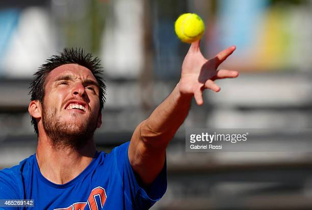 Leonardo Mayer of Argentina serves during a training session prior to a match between Argentina and Brazil as part of Davis Cup 2015 at Tecnopolis in...