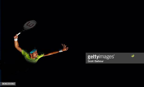 Leonardo Mayer of Argentina serves in his second round match against Rafael Nadal of Spain Leonardo on day three of the 2018 Australian Open at...