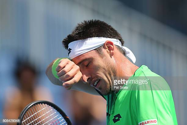Leonardo Mayer of Argentina wipes sweat in his first round match against Dominic Thiem of Austria during day one of the 2016 Australian Open at...