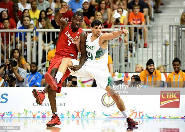 Leonardo Meindl of Brazil and Andrew Nicholson of Canada compete for position in the gold medal game in men's basketball during the 2015 Pan Am Games...