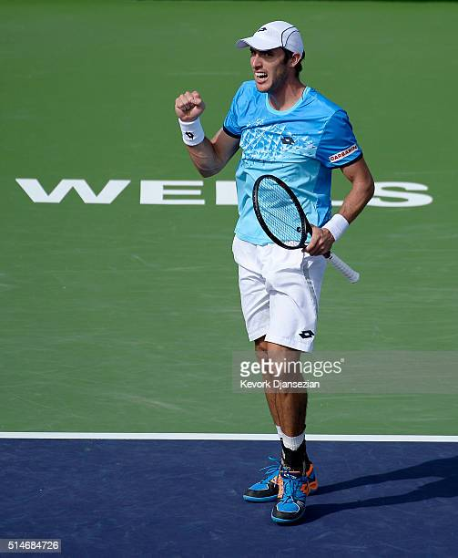 Leonardo Meyer of Argentina celebrates after defeating Sam Groth of Australia during day four of the BNP Paribas Open at Indian Wells Tennis Garden...