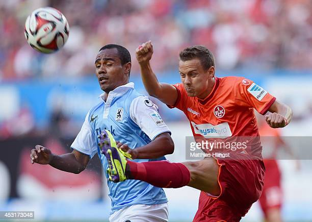 Leonardo of 1860 Muenchen and Chris Loewe of Kaiserslautern compete for the ball during the Second Bundesliga match between 1 FC Kaiserslautern and...