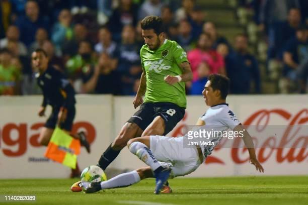 Leonardo Pais of Juarez fights for the ball during the semifinal match between Juarez and Pumas UNAM at Estadio Olimpico Benito Juarez on April 3...