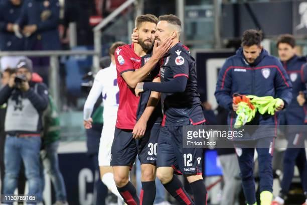 Leonardo Pavoletti and Fabrizio Cacciatore of Cagliari celebrate victory at the end of the Serie A match between Cagliari and ACF Fiorentina at...