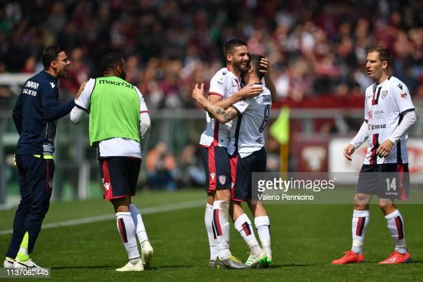 Leonardo Pavoletti of Cagliari celebrates a goal with team mate Luca CigariniÊduring the Serie A match between Torino FC and Cagliari at Stadio...