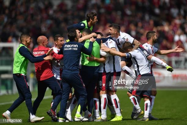 Leonardo Pavoletti of Cagliari celebrates a goal with team mates during the Serie A match between Torino FC and Cagliari at Stadio Olimpico di Torino...