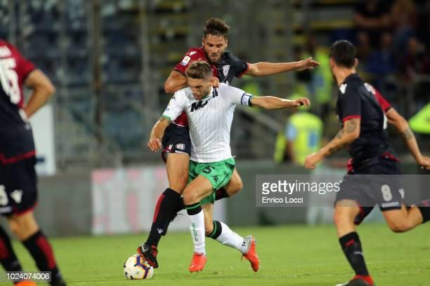 Leonardo PAvoletti of Cagliari in contrast during the serie A match between Cagliari and US Sassuolo at Sardegna Arena on August 26 2018 in Cagliari...
