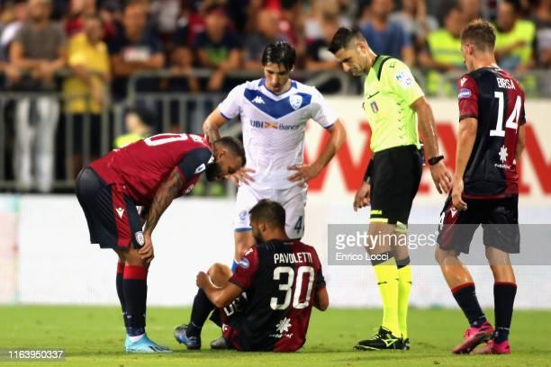 Leonardo Pavoletti of Cagliari injured during the Serie A match between Cagliari Calcio and Brescia Calcio at Sardegna Arena on August 25 2019 in...