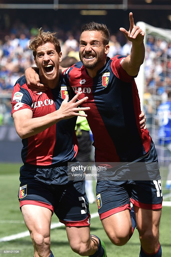 Leonardo Pavoletti (R) of Genoa CFC celebrates after scoring the opening goal with team mate Cristian Ansaldi during the Serie A match between UC Sampdoria and Genoa CFC at Stadio Luigi Ferraris on May 8, 2016 in Genoa, Italy.