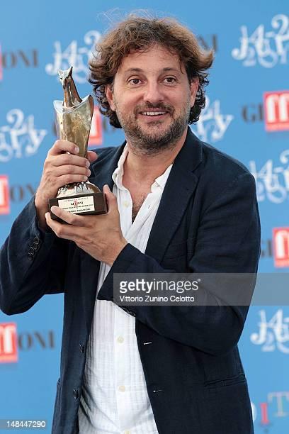 Leonardo Pieraccioni poses with the Giffoni Award on July 16, 2012 in Giffoni Valle Piana, Italy.