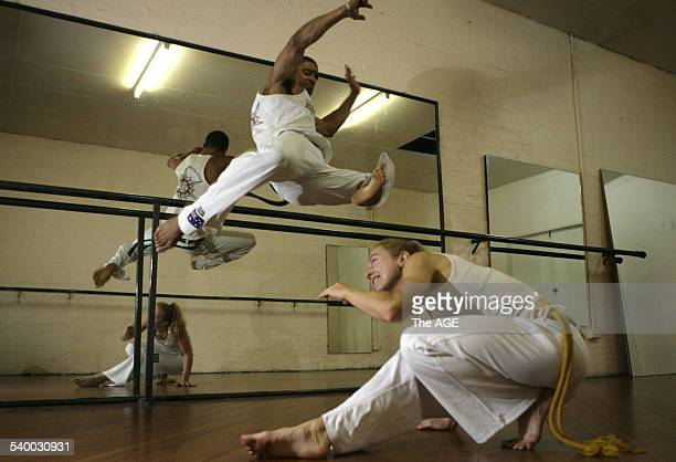 Leonardo Pinentel known in the Capoeira world as Vira Lata leaps over Kerrie Sinclair in a pracitce session of the Brazilian martial art that is...