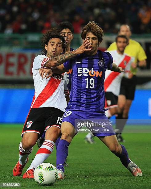 Leonardo Pisculich of River Plate tackles Sho Sasaki of Sanfreece Hiroshima during the FIFA Club World Cup Semi Final match between Sanfrecce...