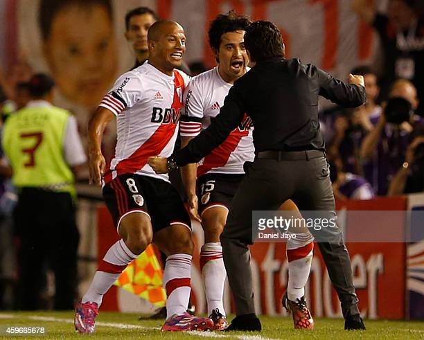Leonardo Pisculichi of River Plate celebrates with Carlos Sanchez and Marcelo Gallardo coach of River Plate after scoring during a second leg...