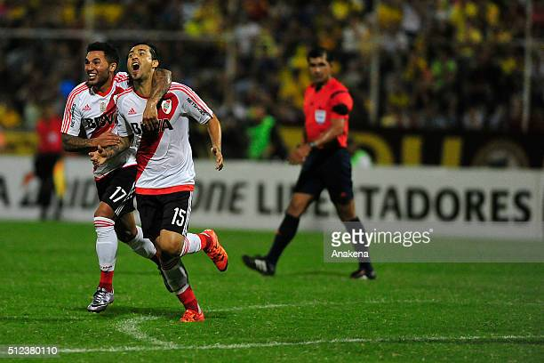 Leonardo Pisculichi of River Plate celebrates with teammate Tabare Viudez after scoring the opening goal during a group stage match between...