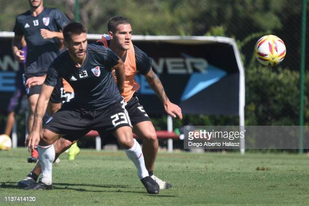 Leonardo Ponzio and Bruno Zuculini of River Plate compete for the ball during a training session at River Camp Ezeiza on March 21 2019 in Buenos...