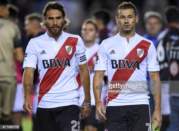 Leonardo Ponzio and Rodrigo Mora of River Plate leave the field after s match between Lanus and River Plate as part of the Superliga 2017/18 at...
