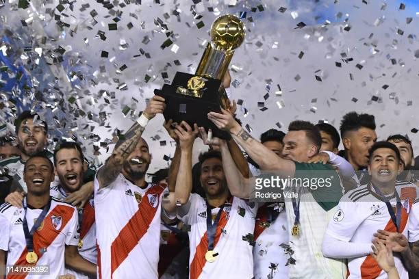 Leonardo Ponzio Javier Pinola and Franco Armani lift the CONMEBOL Recopa cup after the second leg match of the final of the CONMEBOL Recopa...
