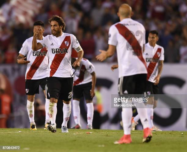 Leonardo Ponzio of River Plate celebrates with teammates after scoring the first goal of his team during a match between River Plate and Boca Juniors...