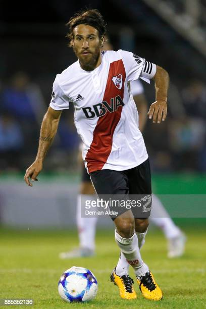 Leonardo Ponzio of River Plate drives the ball during a match between Gimnasia y Esgrima La Plata and River Plate as part of the Superliga 2017/18 at...