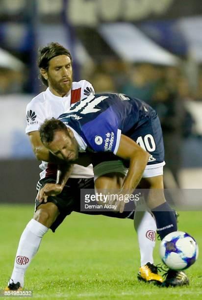 Leonardo Ponzio of River Plate fights for the ball with Brahian Aleman of Gimnasia y Esgrima during a match between Gimnasia y Esgrima La Plata and...