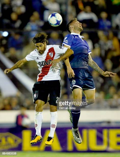 Leonardo Ponzio of River Plate fights for the ball with Nicolas Mazzola of Gimnasia y Esgrima during a match between Gimnasia y Esgrima La Plata and...