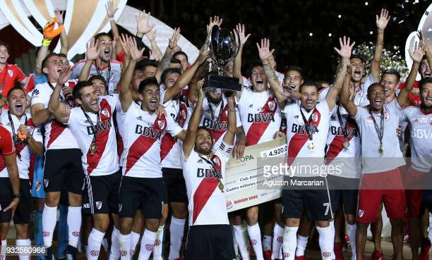 Leonardo Ponzio of River Plate holds up the Supercopa Argentina 2018 throphy with his teammates after winning the final match against Boca Juniors at...
