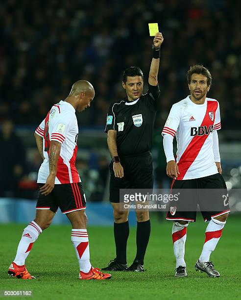Leonardo Ponzio of River Plate is shown the yellow card by referee Alireza Faghani during the FIFA Club World Cup Final match between River Plate and...